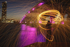 Spinning fire from the bridge at night Stock Photography