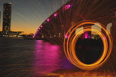 Spinning fire from the bridge at night Royalty Free Stock Photos