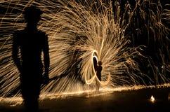 Spinning fire rod show. Show spinning fire rod by a boy at samed island, THAILAND royalty free stock image