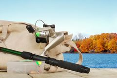 Spinning fishing equipment on a dock in the autumn Royalty Free Stock Photos