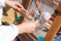Spinning frame with wool fabrics Royalty Free Stock Images