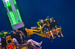 Spinning Fun. Several fair-goers are spun and swept through the air on an amusement park ride during the 2014 Wisconsin State Fair Royalty Free Stock Photos