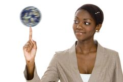 Spinning Globe. A young woman holds a spinning globe on the end of her finger Stock Photo