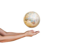 Spinning globe with hands holding. Isolated on white background Royalty Free Stock Photo