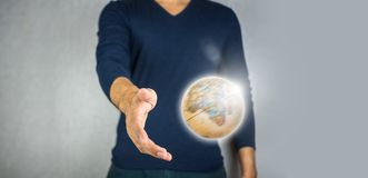 Spinning globe and open hand. World environmental Stock Image