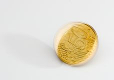 Spinning golden coin Stock Image