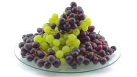 Spinning Grapes on glass table, long shot stock footage