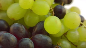 Spinning Grapes on glass table, pan from right stock footage