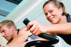 Spinning in the gym Stock Images