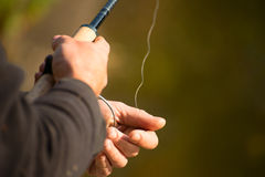 Spinning in the hands of the angler Royalty Free Stock Photo