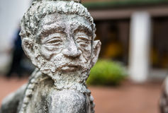 Spinning hermit statue made of marble. stock image