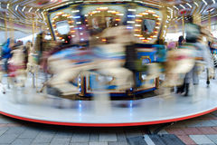 Spinning Holiday Carousel in Seattle. Seattle, WA, USA December 21, 2016: Moving Holiday Carousel at Westlake Park in Seattle, Washington Stock Images