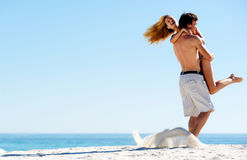 Spinning hug. Happy couple playing on the beach, summer spin and hug embrace Stock Photography