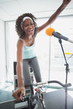 Spinning instructor motivating her class Stock Photography