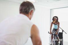 Spinning instructor motivating her class Stock Photo