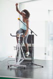 Spinning instructor motivating her class Stock Images