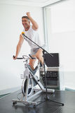 Spinning instructor motivating his class Royalty Free Stock Photo