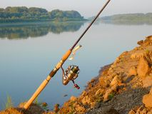 Spinning with jig bait on the. River beach Stock Image