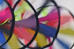 Spinning kite. A multi-coloured kite with round canvas elements spinning round, photographed in motion, with movement Royalty Free Stock Photo