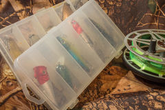 spinning lures in the box and fishing reel Royalty Free Stock Photos