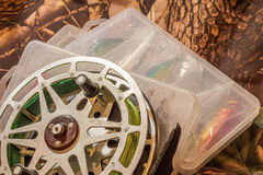 spinning lures in the box and fishing reel Stock Photo