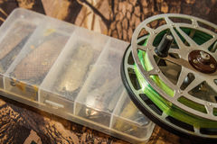 spinning lures in the box and fishing reel Royalty Free Stock Images
