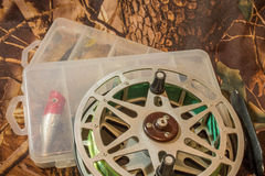 spinning lures in the box and fishing reel Royalty Free Stock Image