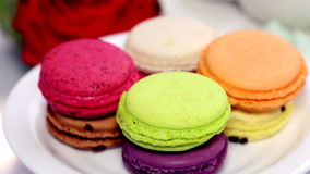 Spinning macaron on the plate Royalty Free Stock Photography