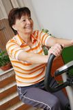 Spinning mature woman Stock Photos