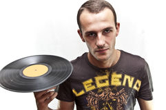Spinning music. Young man (possibly a dj) spinning a vinyl record on his finger Royalty Free Stock Photos