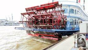 Spinning paddle wheel on back side of boat Stock Photo