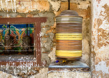 Spinning prayer wheel Stock Photos