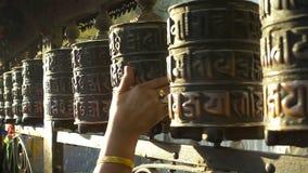 Spinning prayer wheels at the Swayambhunath Stupa, Kathmandu, Nepal.