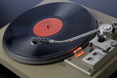 Spinning Record Player. Retro record player spinning with needle approaching the record Stock Image