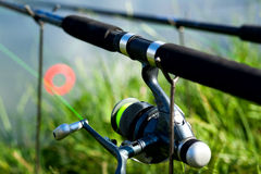 Spinning reel. On a rod. Summertime day fishing Royalty Free Stock Photography