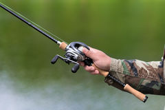 Spinning reel and casting Royalty Free Stock Photography