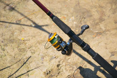 Spinning and reel for fishing.  Royalty Free Stock Photo