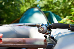 Spinning reel for fishing on boat. Spinning reel for fishing on inflatable rubber boat Royalty Free Stock Photos