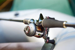 Spinning reel for fishing on boat. Spinning reel for fishing on inflatable rubber boat Royalty Free Stock Image