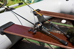 Spinning reel for fishing on boat. Spinning reel for fishing on inflatable rubber boat Stock Photo