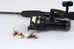 Spinning reel and lures Royalty Free Stock Photo