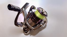 Spinning reel mounted with yellow thread. Selective focus Stock Images