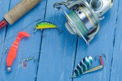 Spinning, reel, wobblers and silicone bait. Hard bait. Fishing set Royalty Free Stock Photography