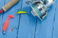 Spinning, reel, wobblers and silicone bait. Hard lures. Fishing set Royalty Free Stock Photos