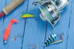 Spinning, reel, wobblers and silicone bait. Mormyshki. Lures for winter fishing. Hard bait. Royalty Free Stock Images