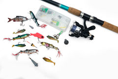 Spinning rod, reel and fishing baits isolated on white backgroun Stock Images