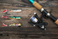 Spinning rod, reel and fishing baits Stock Photos