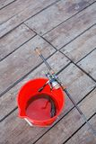 Pike, spinning rod and reel. Spinning rod and reel and pike in the red bucket Royalty Free Stock Photos