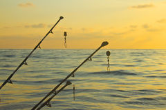 Spinning rods. In front of sea Royalty Free Stock Photos