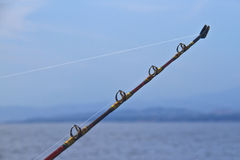 Spinning rods in front of sea Royalty Free Stock Photo